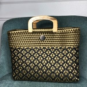 Handbags - Plastic Hand Woven Bag in Black and Gold.